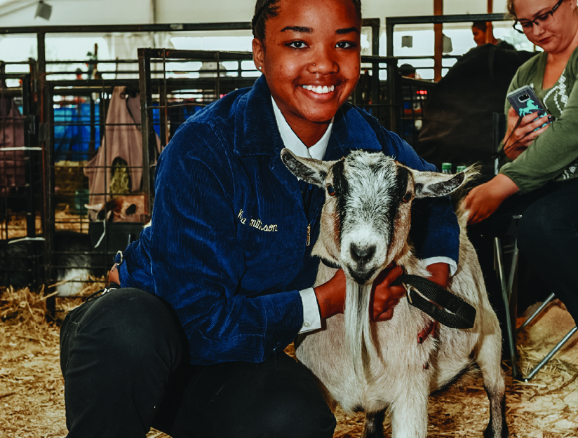 FFA member with a goat